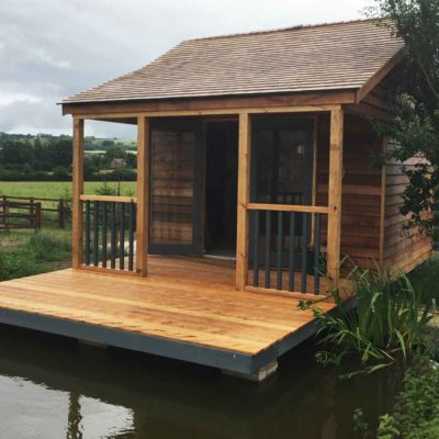 wooden summer-house on the lake for fishing