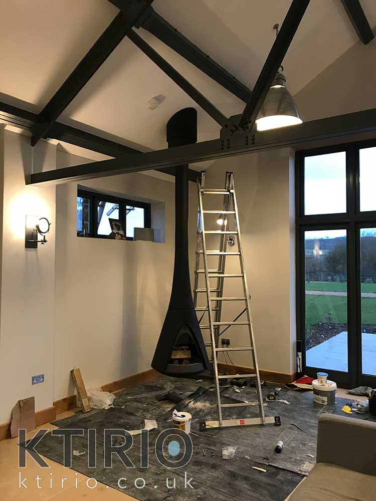 Barn conversion with hanging fireplace